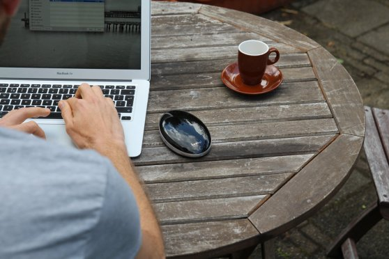 keezel-man-working-at-a-coffee-table-with-macbook-and-keezel-8ad2ad-large-1436372578
